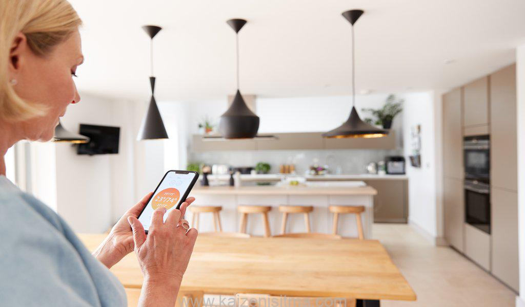 Close Up Of Woman Using App On Smart Phone To Control Central Heating Temperature In House - Close Up Of Woman Using App On Smart Phone To Control Central Heating Temperature In House v 1576176972 - Low energy heating